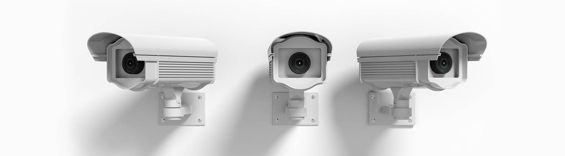 Three security surveillance cameras