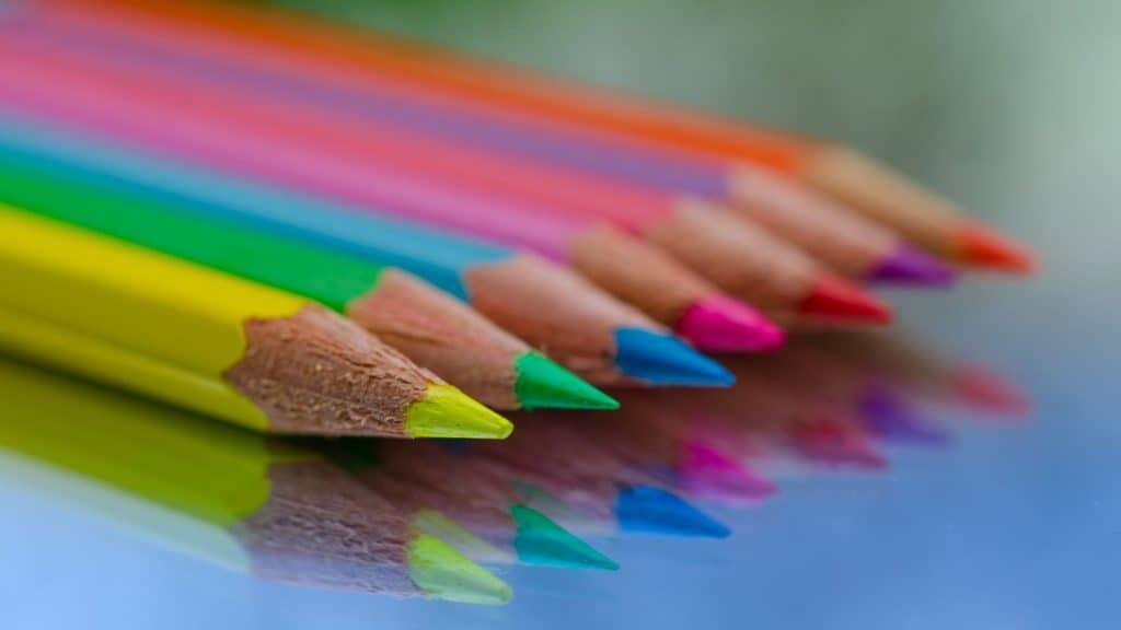 seven bright colored pencils