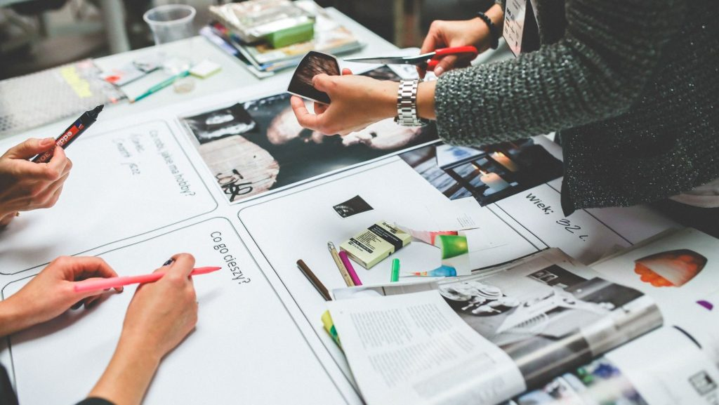designers working on a brand strategy on a white table