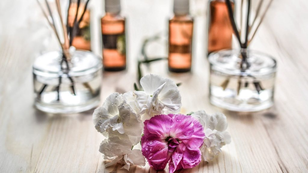 white and purple flowers with wellness essential oils