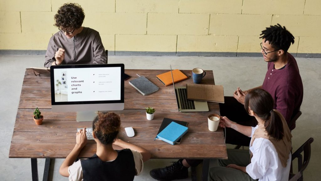 group of business people working on their brand at a table