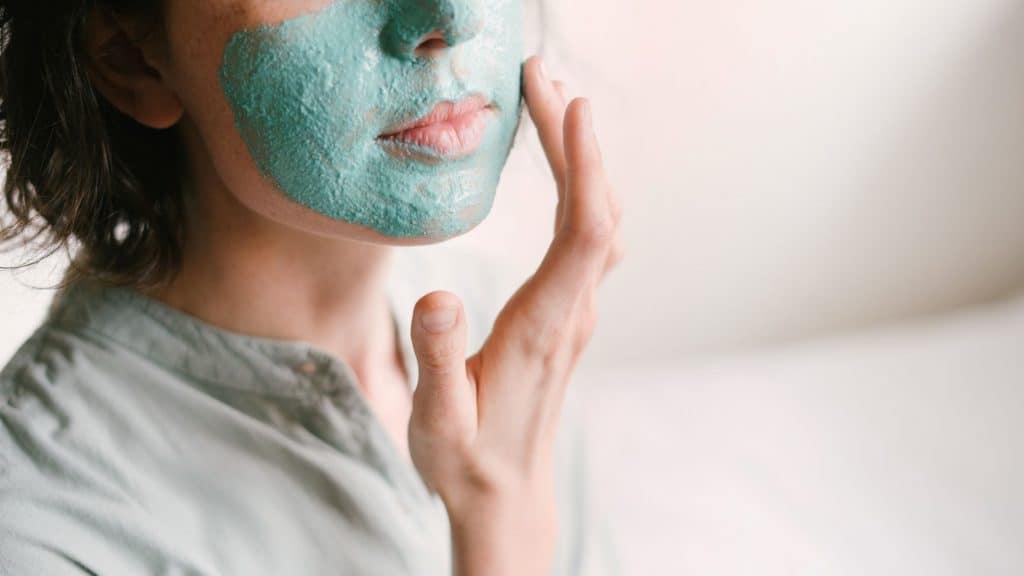 woman applying face mask