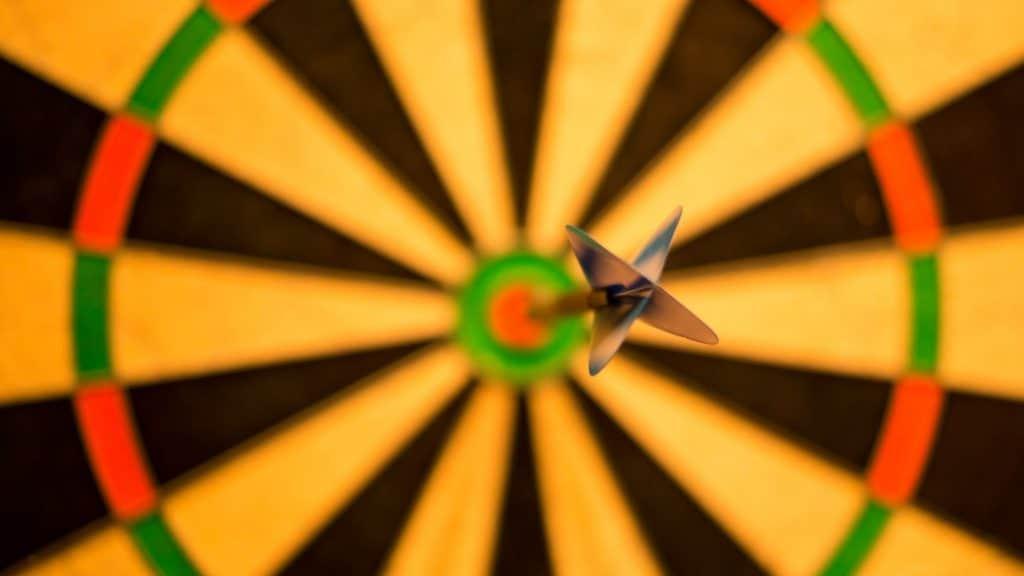 bulls eye with an arrow in the target