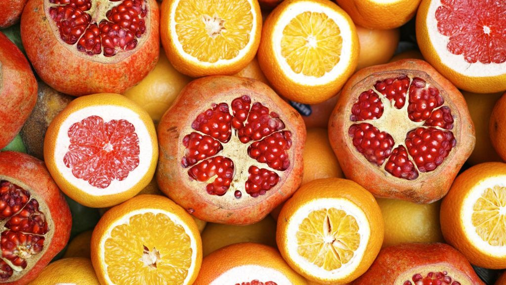 close up photo of orange and pomegranate slices