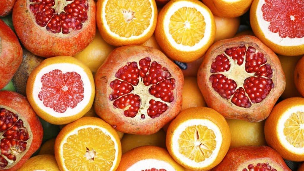 close up photo of orange and pomegranate slices