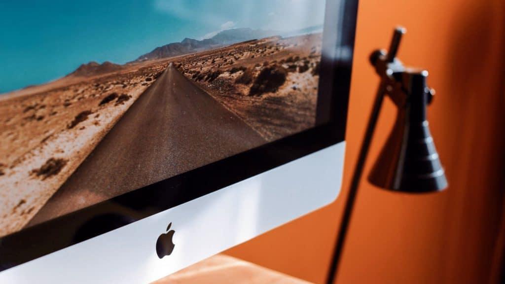 apple laptop on a desk