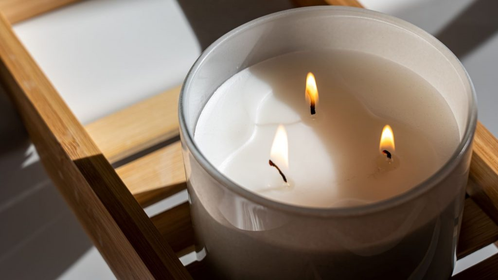 white three wick candle