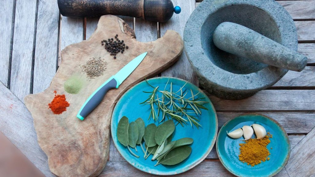 mortar pestle and herbs