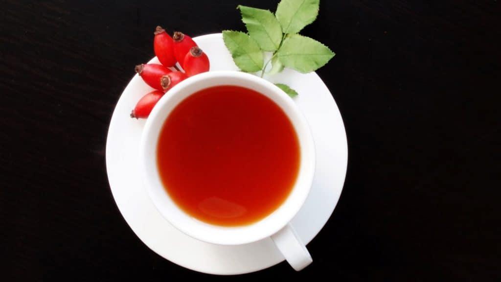 red herbal tea in a white mug
