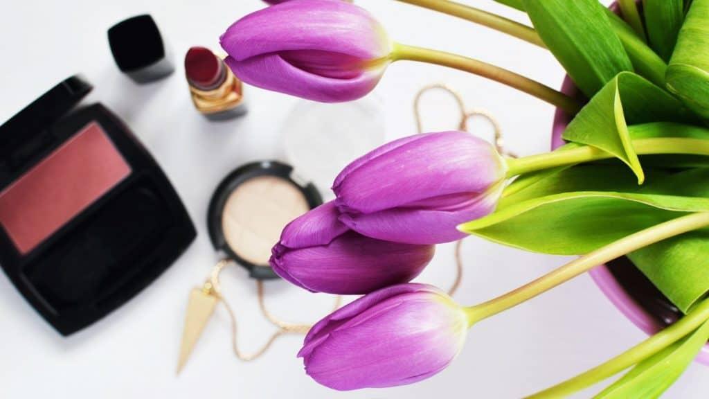 cosmetics and purple tulips