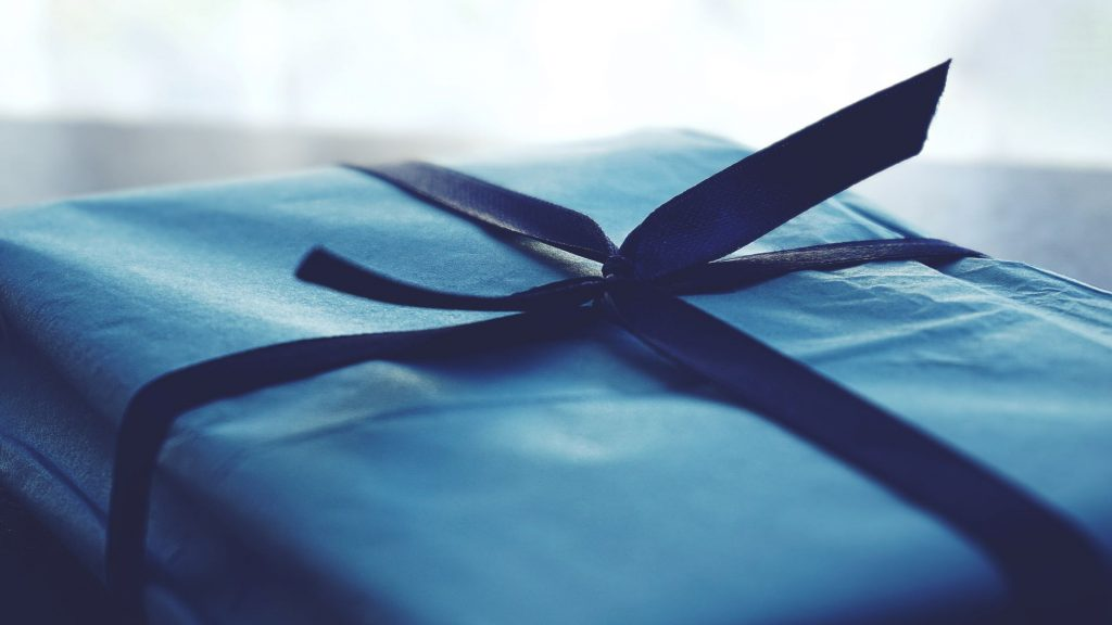 close up of package wrapped in blue reusable cloth