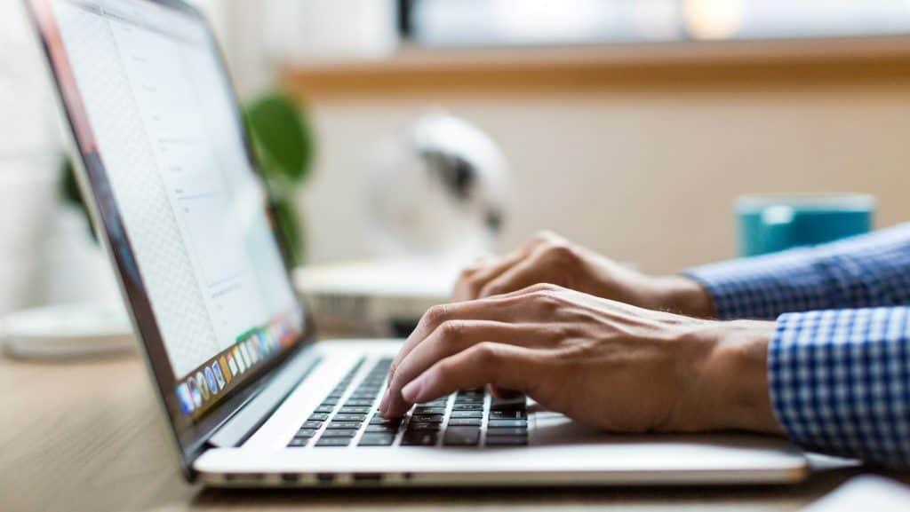entrepreneur using macbook