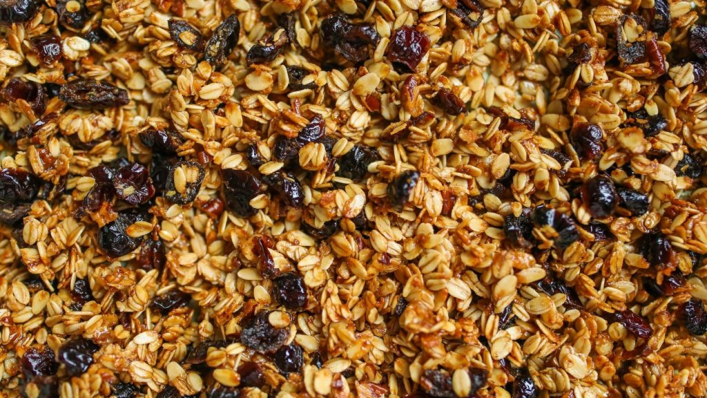 close up photo of granola and berries
