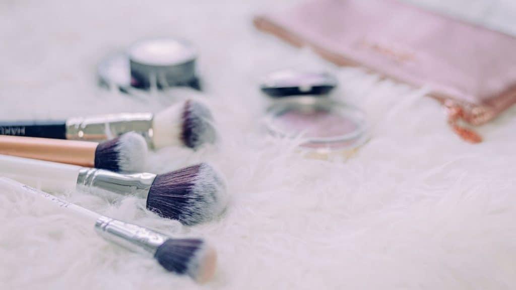 makeup brushes on soft white carpet
