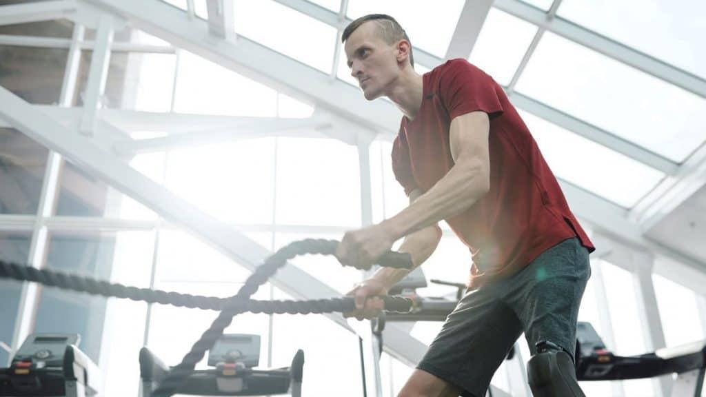 man exercising in red shirt