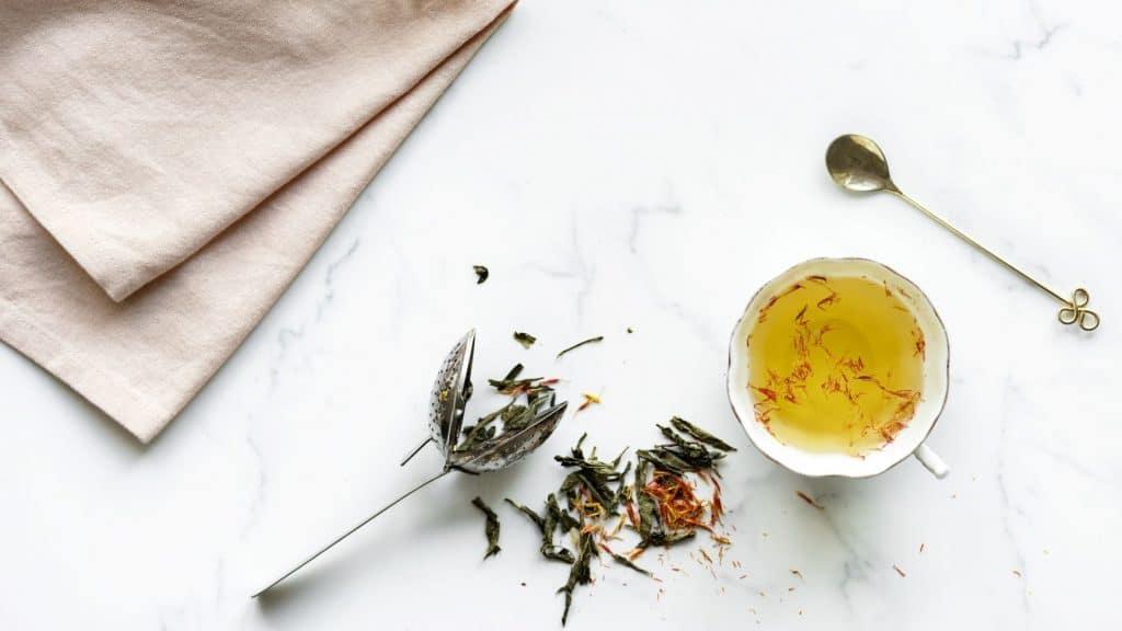 tea in mug on white marble table