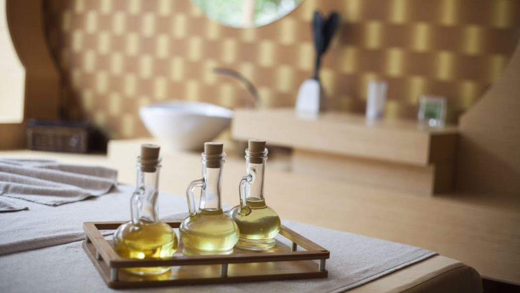 essential oils sitting on a table