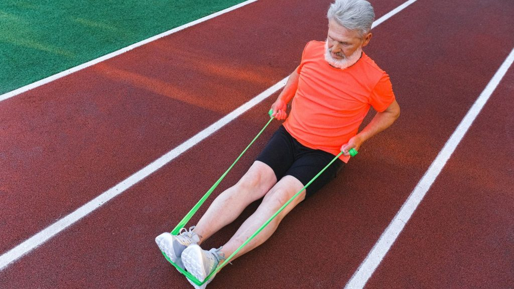 man stretching on a running track