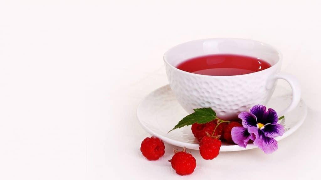 white mug of raspberry tea