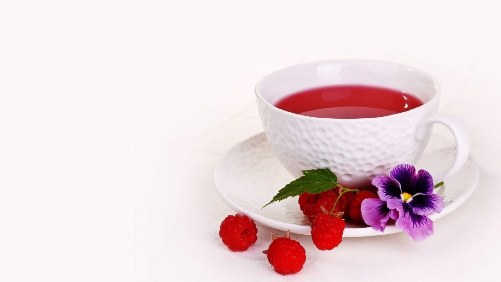 white mug of raspberry tea