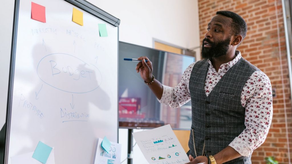 wellness entrepreneur with a whiteboard