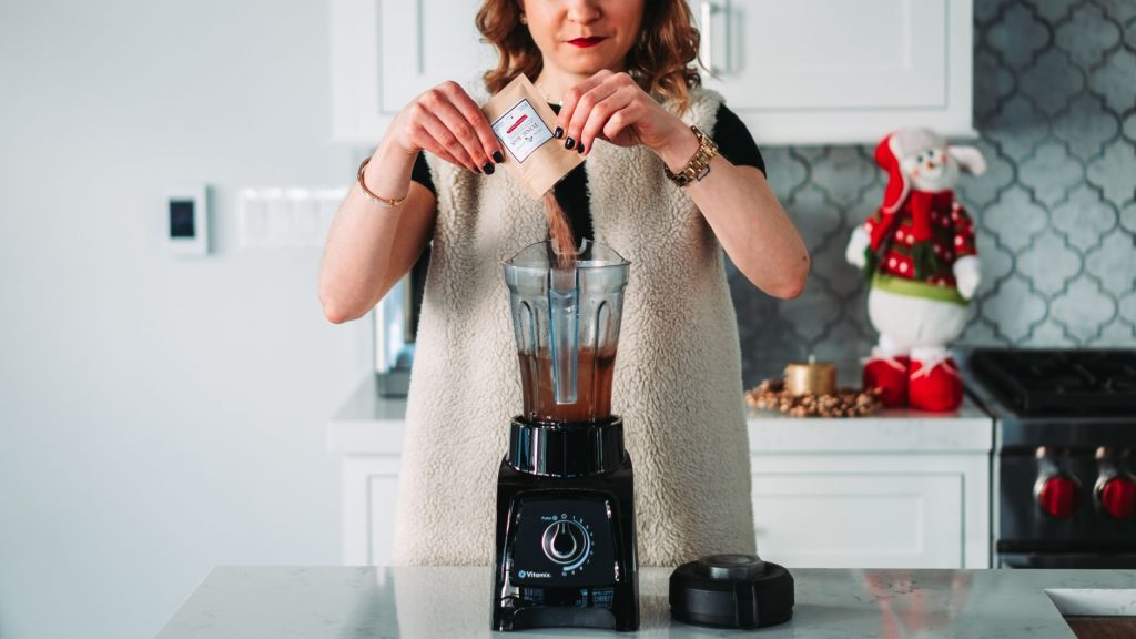 woman making protein shake