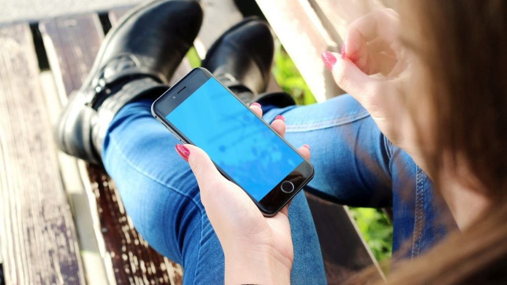 woman using remote wellness app