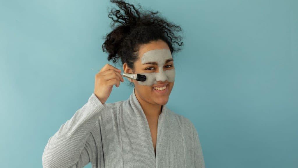 woman applying skincare product