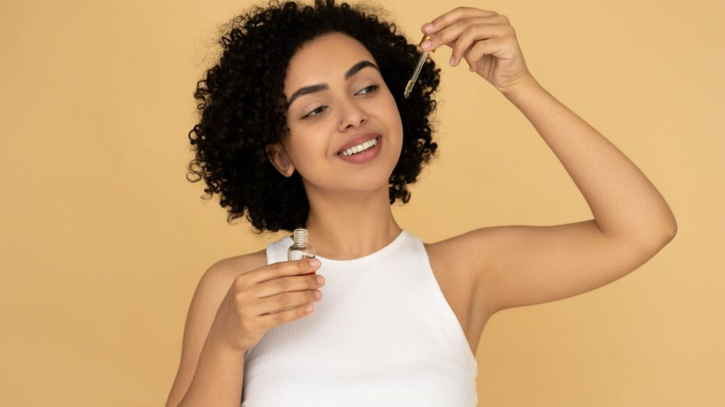 woman using skincare products